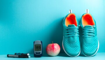 Running shoes, an apple, and a glucose monitor displaying 105 mg/dl glucose